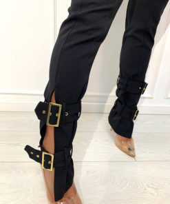 Pants with golden buckles